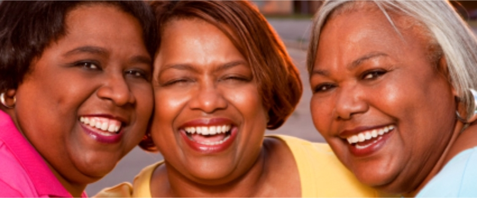 three woman smiling