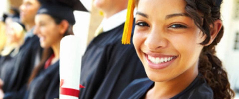 women happily graduating
